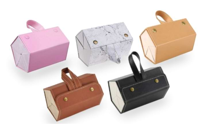 Five colors of the Foldable Sunglasses Case on display. From left to right top row: pink, white marble, tan. Bottom row: brown, black.
