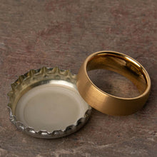 Open Bottles with the Dumbledore Gold Tungsten Carbide Mens Wedding Ring