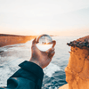 Lensball Australia - Clifftop shot of lensball in hand
