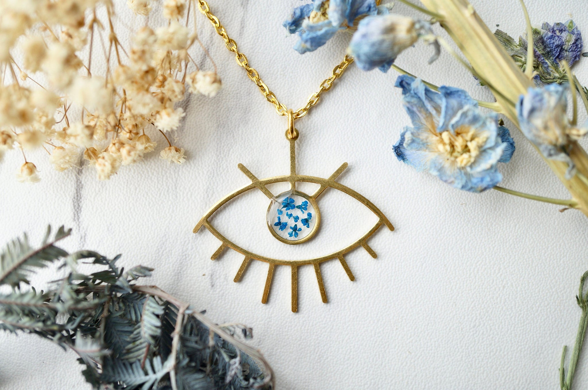 Real Pressed Flowers in Resin, Gold Necklace, Brass Eye in Blue