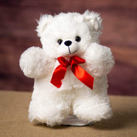 A white bear that is 11 inches tall while standing