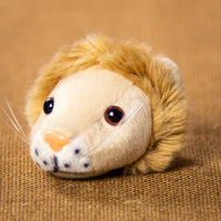 A beige lions head that is 3 inches from top to bottom
