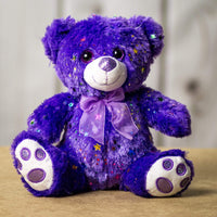 A sparkly purple bear that is 10 inches tall while sitting