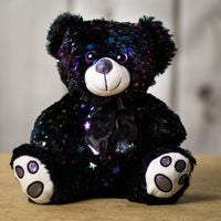A sparkly black bear that is 10 inches tall while sitting