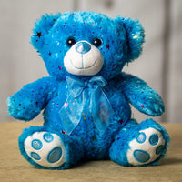 A sparkly blue bear that is 10 inches tall while sitting