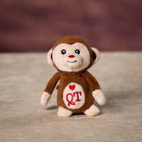 A brown monkey that is 4 inches tall while sitting