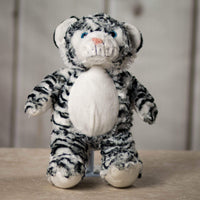 A black and white stripped tiger that is 15 inches tall while standing