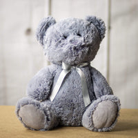A grey bear that is 14 inches tall while sitting
