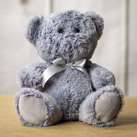 A gray bear that is 10 inches tall while sitting