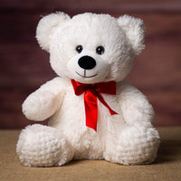 A white bear that is 10.5 inches tall while sitting