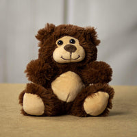 A dark brown bear that is 7 inches tall while sitting