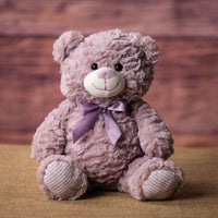 A lavender bear that is 10 inches tall while sitting