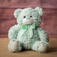 A mint bear that is 10 inches tall while sitting