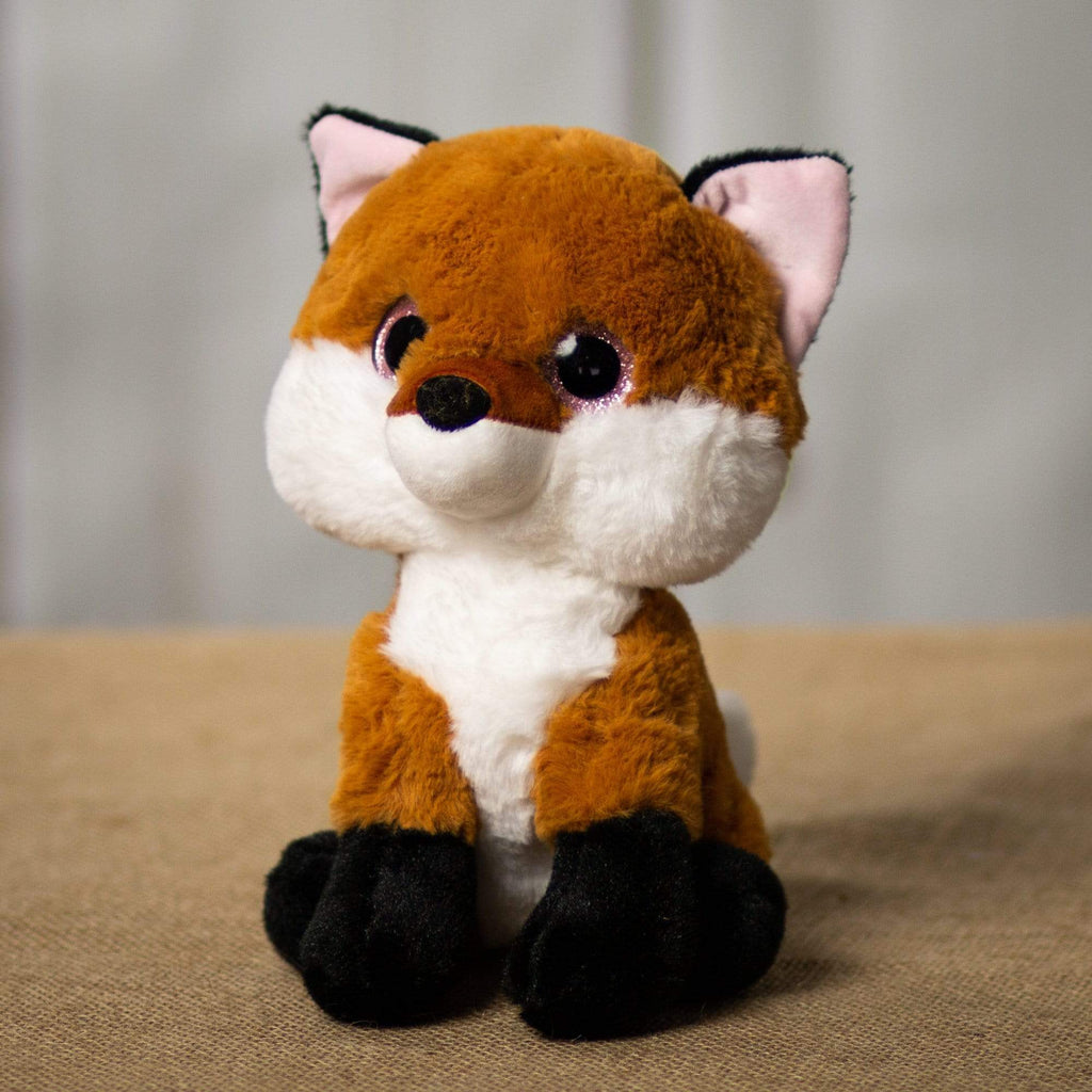 A fox that is 8 inches tall while sitting