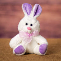 A white bunny with purple ears and feet that is 6 inches tall while sitting