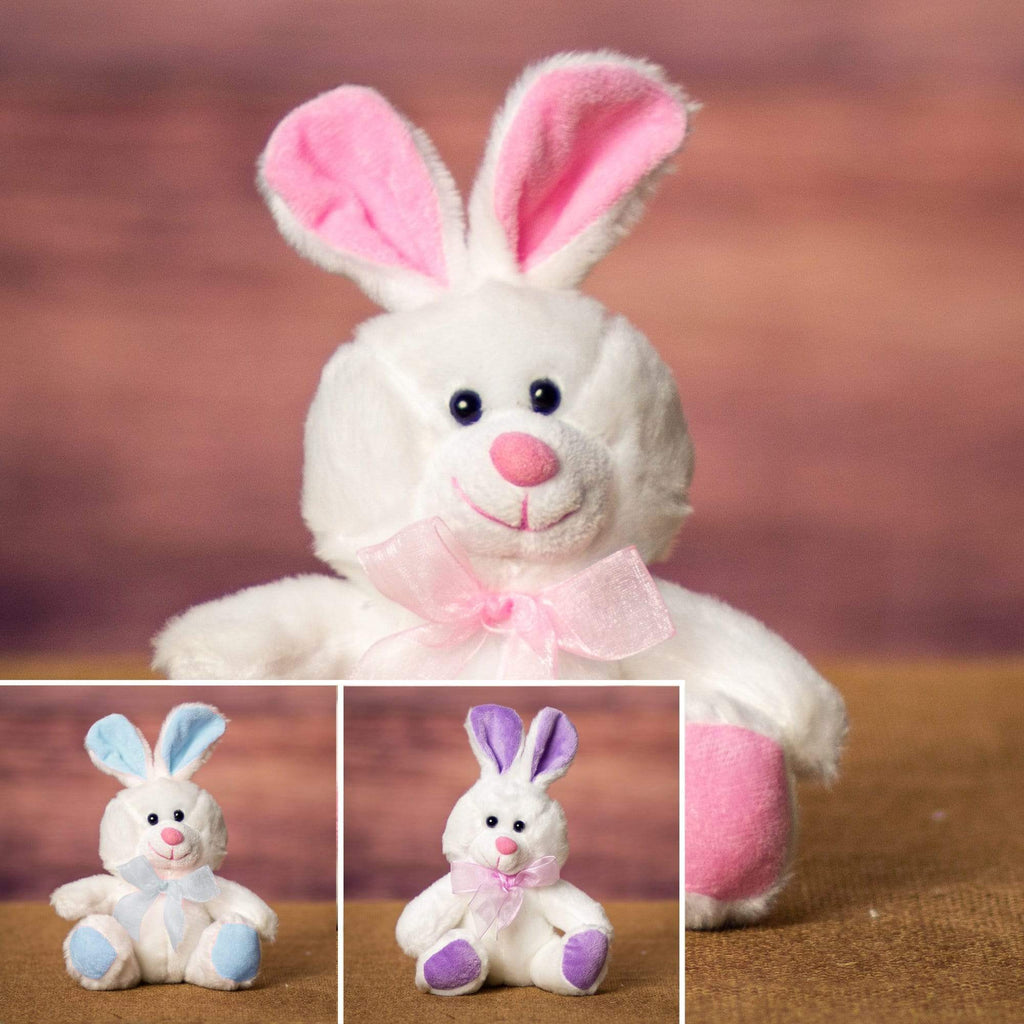 A white bunny with pink, purple, or blue ears and feet that is 6 inches tall while sitting