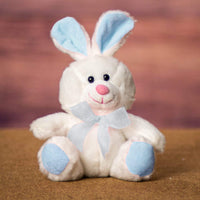 A white bunny with blue ears and feet that is 6 inches tall while sitting