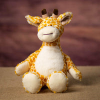 A giraffe that is 12 inches tall while standing in a sitting position