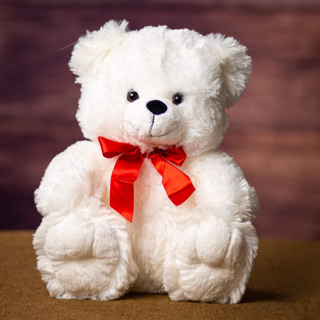 A white bear that is 12 inches tall while sitting