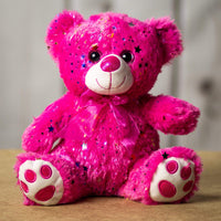 A sparkly pink bear that is 10 inches tall while sitting