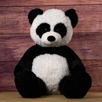 A black and white panda that is 44 inches tall while standing