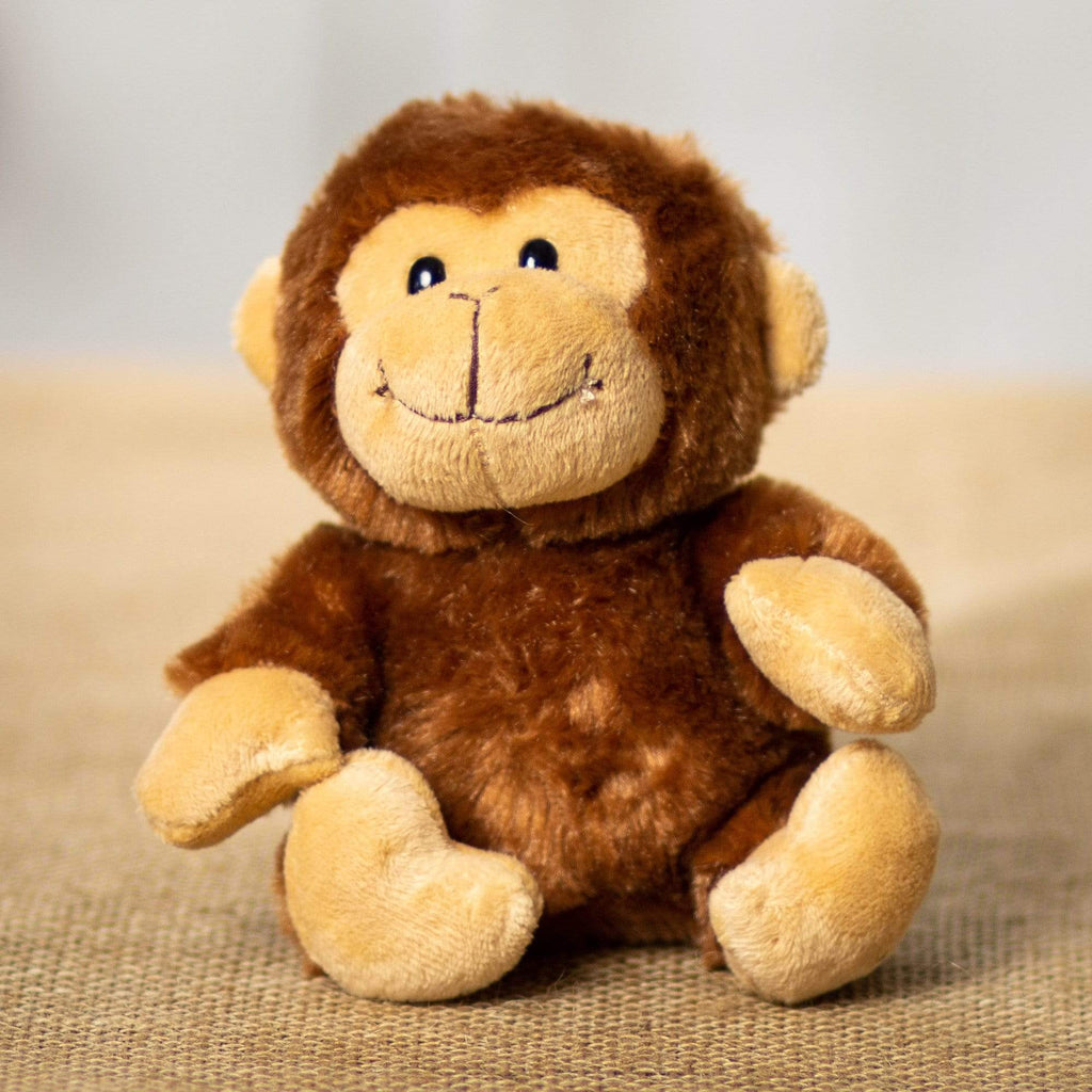 A brown yelling monkey that is 5 inches tall while sitting