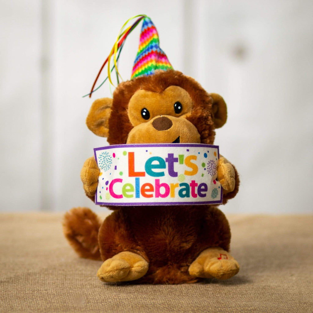 "A brown monkey that is 9 inches tall while standing wearing a birthday hat holding a sign that says ""Lets Celebrate"""