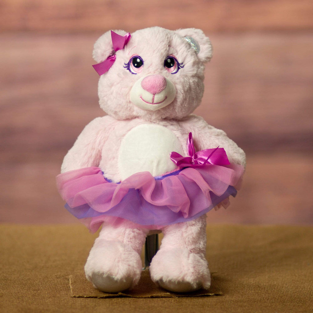 A pink bear that is 12 inches tall while standing wearing a tutu