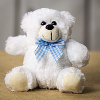 A white bear that is 7 inches tall while sitting