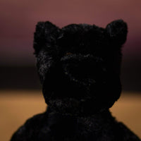 Close up of a floppy black panther that is 12 inches tall while standing