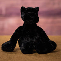A floppy black panther that is 12 inches tall while standing in a sitting position