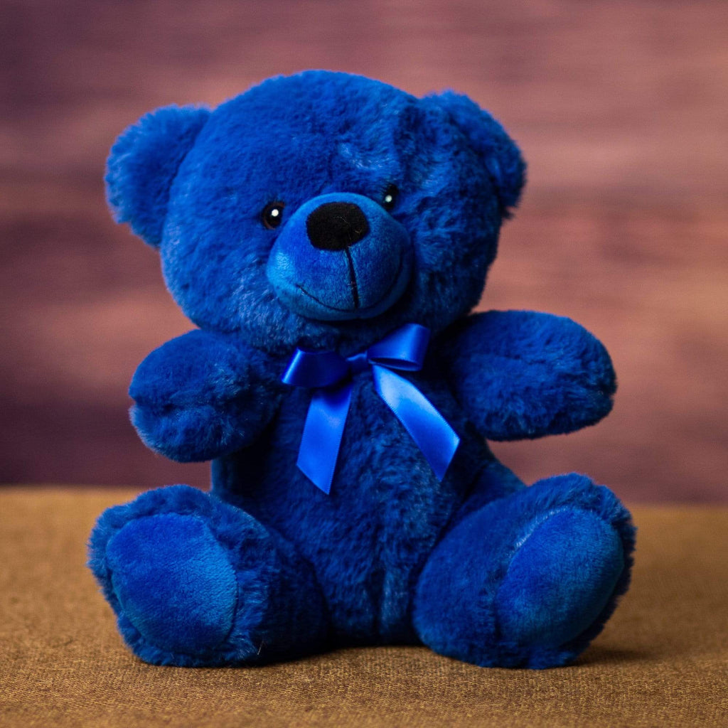 A dark blue bear that's 9 inches tall while sitting
