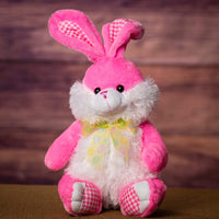 A pastel pink bunny that is 14 inches tall while sitting