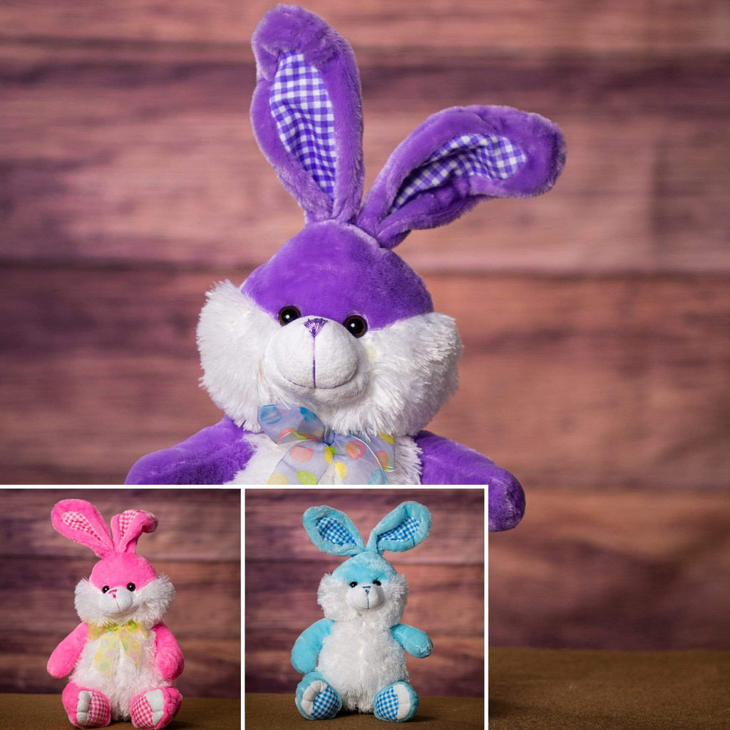 A pastel purple, blue, and pink bunnies that are 14 inches tall while sitting