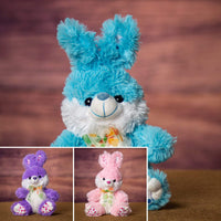A blue, pink, and purple bunny that is 9 inches tall while sitting
