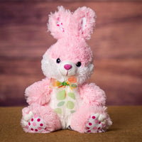 A pink bunny that is 9 inches tall while sitting