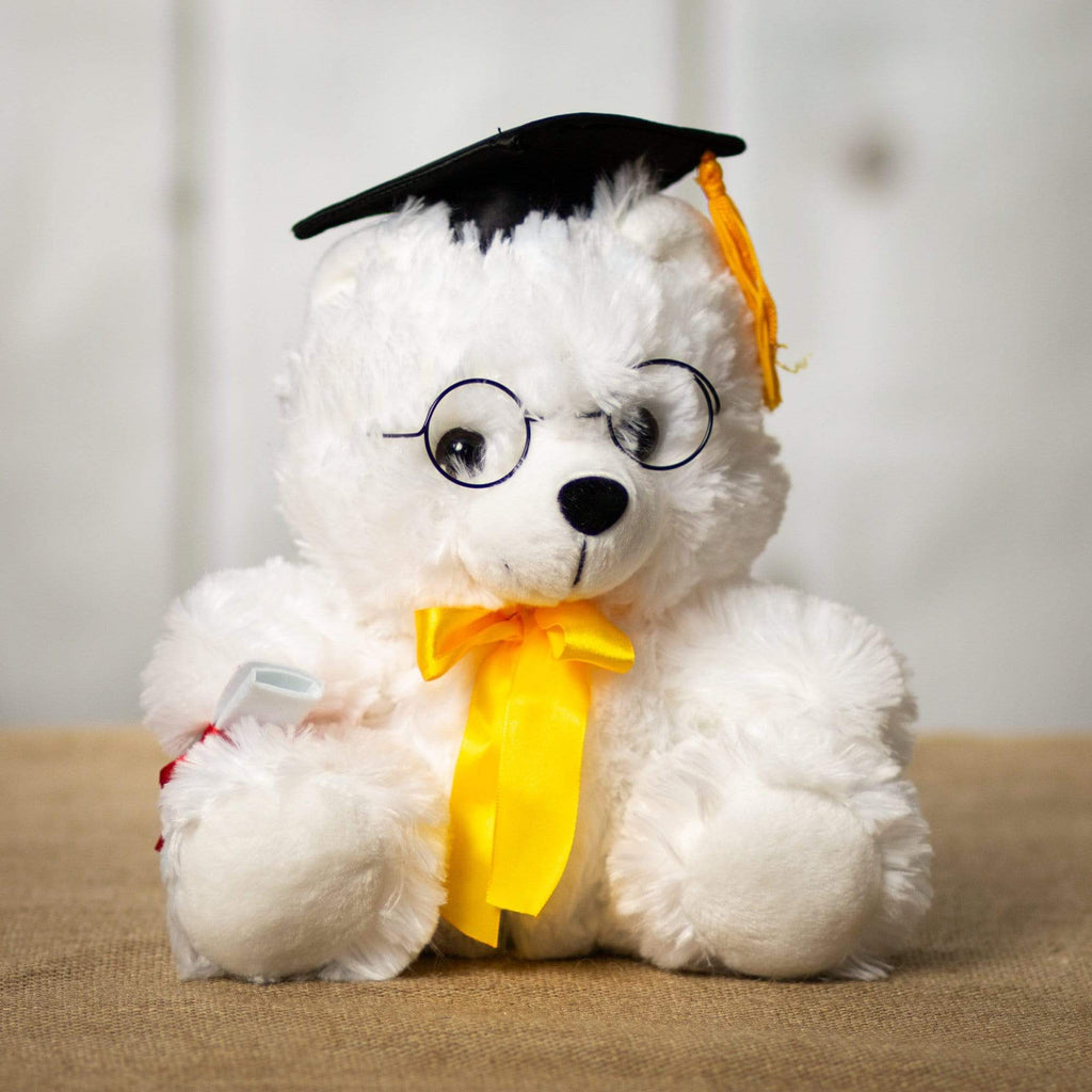 A white grad bear that is 10 inches tall while standing