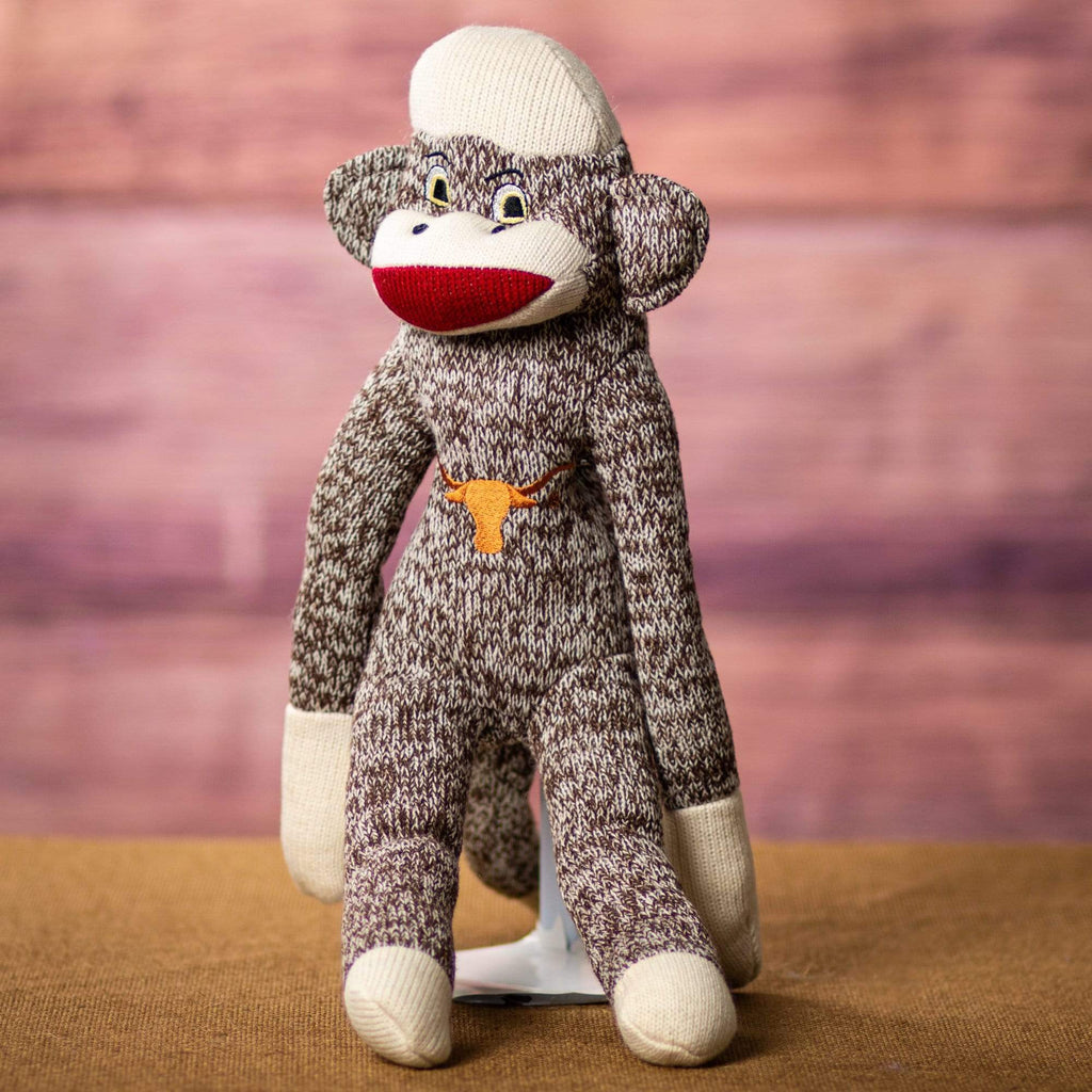 A brown UT sock monkey that is 18 inches tall while standing