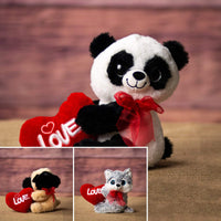 A panda, pug, and a wolf that are 10 inches tall while sitting holding a red Love heart