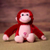 A red monkey that is 10 inches tall while standing