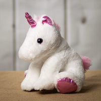 A white unicorn that is 11 inches tall while sitting