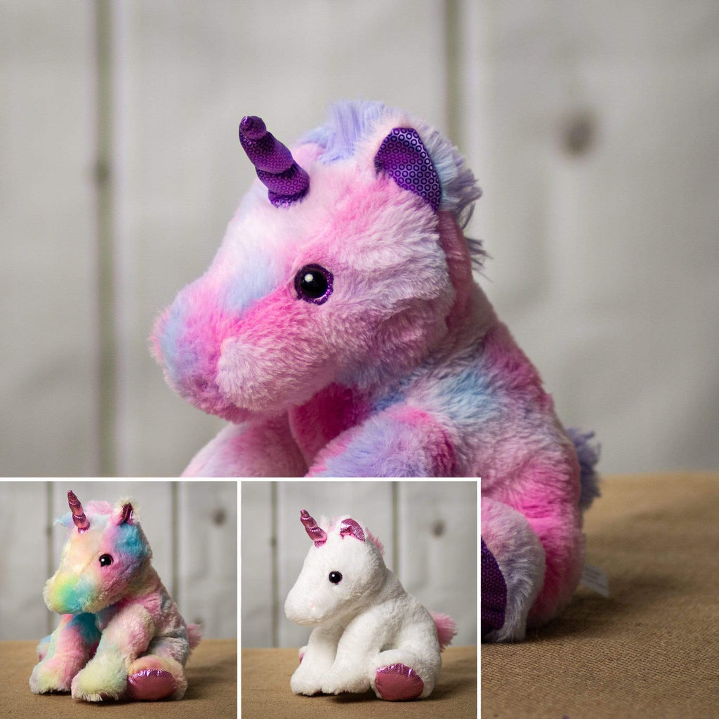 A white, pink, and rainbow colored unicorn that are 11 inches tall while sitting