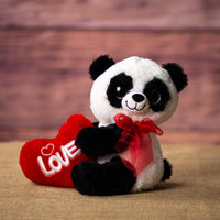 A panda that is 10 inches tall while sitting holding a red Love heart