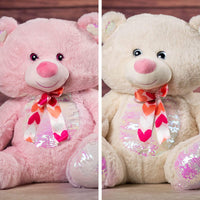 A pink and cream bear that are 21 inches tall while sitting with a sequin belly and feet