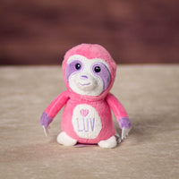 A pink monkey that is 4 inches tall while sitting