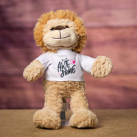 A beige lion that is 15 inches tall while standing wearing a white shirt