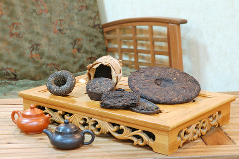 puerh tea cakes on a serving tray
