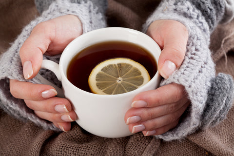 woman holding cup of tea on a cold day