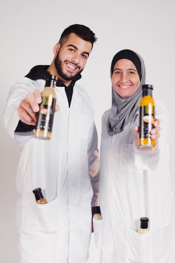 surria and ameen holding salad dressing