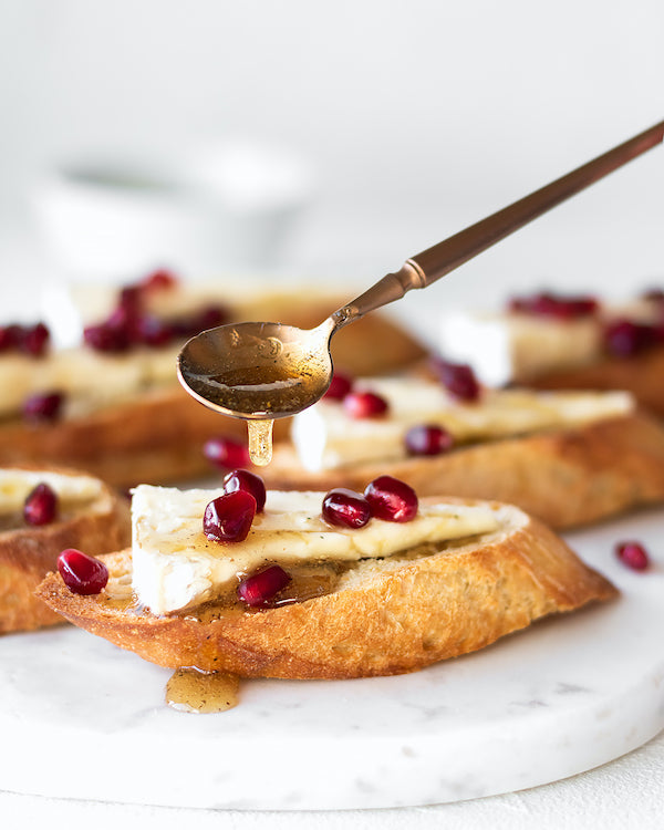 pomegranate crostini with spoon